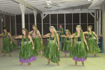 Hula Intensive students dancing in ti leaf skirts they made
